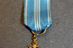 4.-Suomen-olympialainen-2.-lk-ansioristi-takaa