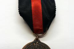 5.-Aunuksen-muistomitali-taka